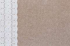 Natural linen texture with white lace. On the left side Royalty Free Stock Images