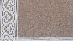 Natural linen texture with white lace. On the left side and ribbon at bottom. Empty copyspace royalty free stock photos
