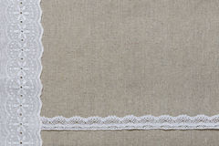 Natural linen texture with white lace and ribbon Royalty Free Stock Images