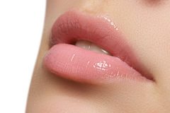 Natural lips. Close up shoot of young beautiful girl with perfect skin. Lips Stock Images