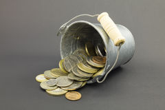 Natural little old metal bucket with coins Stock Photography