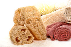 Natural Loofah Scrub Sponge and Soft Cotton Towels royalty free stock images