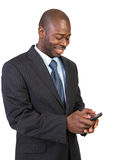 Natural Looking African Male Texting Isolated Royalty Free Stock Photography