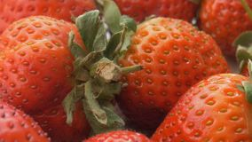 Natural looking fresh red strawberry. stock footage
