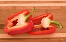 Natural looking red pepper on chopping board Royalty Free Stock Photo