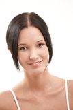 Natural looking young woman smiling Stock Images