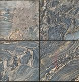 Square of four polished marble feature wall tiles. Natural luxury with complex swirls, patterns and designs. Each tile is unique, mainly yellow, blue and grey Royalty Free Stock Photos