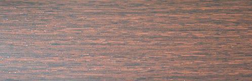 Natural mahogany sawed close-up. Background. Texture royalty free stock photos