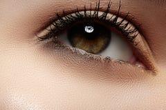 Natural make-up with black mascara on lashes. Woman beautiful eye with naturally long eyelashes. Macro shot. Wellness and spa, health and cosmetics. Natural make Stock Image