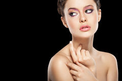 Natural makeup. Beautiful female face with natural makeup, on black background Stock Image