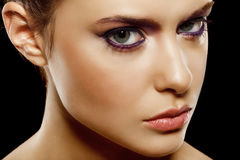 Natural makeup. Beautiful female face with natural makeup, on black background Stock Images