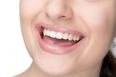 Natural Makeup. Beauty Smile. Sensual Lips. Portrait macro of smiling young woman with piercing and natural makeup Royalty Free Stock Photos