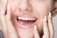 Natural Makeup and French Manicure. Beauty Smile. Portrait macro of smiling young woman with beauty healthy mouth Royalty Free Stock Images