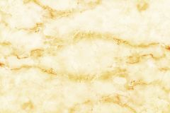 Natural marble with golden texture for background and design ceramic counter luxurious, top view of tiles stone. In seamless pattern royalty free stock photography