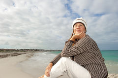 Natural mature woman ocean background Royalty Free Stock Image
