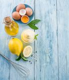 Natural mayonnaise ingredients and the sauce itself. royalty free stock images