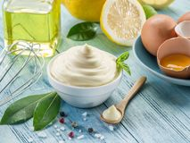 Natural mayonnaise ingredients and the sauce itself. Stock Photography