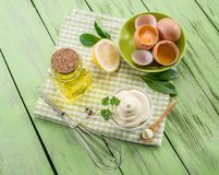 Natural mayonnaise ingredients and the sauce itself. royalty free stock photo