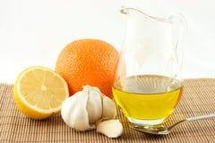 Natural medicaments. Garlic, honey, lemon, olive oil, orange stock photos
