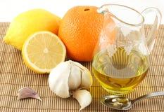 Natural medicaments. Garlic, honey, lemon, olive oil, orange royalty free stock photos