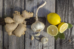 Natural medicine. Ginger,lemon,honey and garlic, fresh and healthy food products, concept for natural medicine royalty free stock images