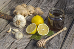Natural medicine. Ginger,lemon,honey and garlic, fresh and healthy food products, concept for natural medicine stock images