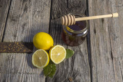 Natural medicine. Ginger,lemon,honey and garlic, fresh and healthy food products, concept for natural medicine stock photo