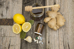 Natural medicine. Ginger,lemon,honey and garlic, fresh and healthy food products, concept for natural medicine royalty free stock photos
