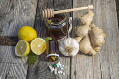 Natural medicine. Ginger,lemon,honey and garlic, fresh and healthy food products, concept for natural medicine royalty free stock photography