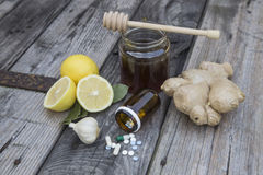 Natural medicine. Ginger,lemon,honey and garlic, fresh and healthy food products, concept for natural medicine stock photography