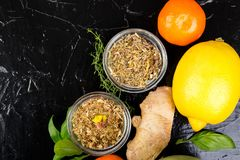 Natural medicine. Treatment for colds. Concept of natural medicine. Natural remedies for colds on black background. Flat lay. Copy space Royalty Free Stock Images