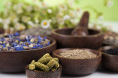 Natural medicine, wooden table background Royalty Free Stock Images
