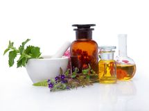 Natural medicines - extract from herbs. Bottle, glass of herbal extract - alternative medicine stock photography