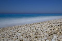 Milos gravel beach, deep blue sea and sky, lefkada, lefkas, greece stock image