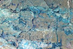 Natural mineral grey stone with blue streaks as texture or background royalty free stock photos
