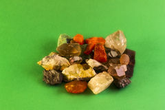 Natural minerals. Color on a green background Stock Images