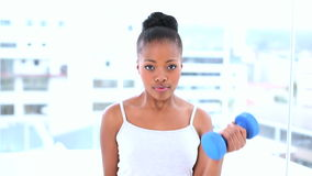Natural model exercising with dumbbells Royalty Free Stock Image