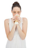 Natural model in white dress drinking coffee Stock Photos