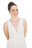 Natural model in white dress posing Stock Photos