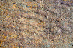 Natural multi colored sedimentary rock background Royalty Free Stock Photography