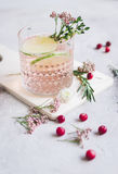 Natural nonalcoholic cocktail with berry and cut lime on stone desk background. Natural nonalcoholic cocktail with berry and cut lime for summer party on stone Stock Images