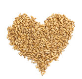 Natural oat grains in form of the heart,  on white Royalty Free Stock Photo