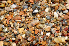 Natural ocean gravel and sand rock. Colorful tropical beach natural ocean gravel and sand rock Stock Images