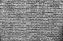Natural old vintage weathered gray solid brick wall. Abstract co. Close-up of natural old vintage weathered gray not plastered solid brick wall. Abstract copy royalty free stock photography