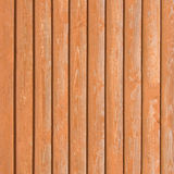 Natural old wood fence planks wooden close board texture overlapping light reddish brown closeboard terracotta background vertical Royalty Free Stock Photography