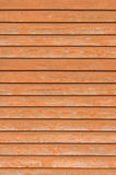 Natural old wood fence wall planks, wooden close board texture, vertical overlapping reddish brown closeboard terracotta rustic. Background pattern Stock Images