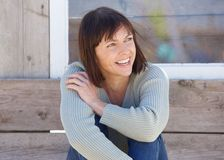 Natural older lady smiling outside Stock Photography