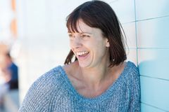 Natural older woman laughing. Close up portrait of a natural older woman laughing Stock Photography