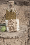Natural olive oil soap bar and oil bottle on wooden table Royalty Free Stock Photos