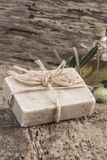 Natural olive oil soap bar and oil bottle on wooden table Royalty Free Stock Photo